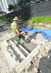 The conservancy's Raymond Skinner walks down steps that once led to the laundry room of the Royal Palm hotel, built by railroad tycoon Henry Flagler.