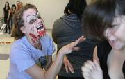 Health Leadership High School teacher Hope Kitts, left, portrays a zombie during a preparedness exercise with 14-year-old student Aylin Yanez.