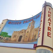 Right: The historic Mission Drive-In and its mural were restored and reopened in May as part of a Mission Marquee Plaza. Right corner: The site of the former Lone Star Brewery still is abandoned after several development fits and starts.