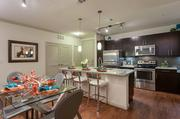 The two-bedroom units at the South Shore District feature stainless steel appliances, counter space and a separate dining area.