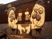 Full disclosure: PSBJ reporter Emily Parkhurst took this photo of two Henry walruses sharing a brew at Naked City Brewery in Greenwood. She loves both the mural and the beer there.