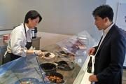 BiBiBop owner Charlie Shin orders a test meal prepared by R&D leader Chung Choe.