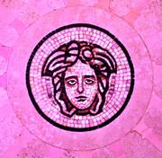 Gianni Versace's designer logo, set in a marble floor in the mansion.