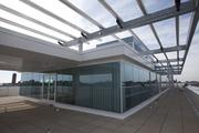 The penthouse has a large deck, trendy architecture and a spectacular view of campus and beyond.