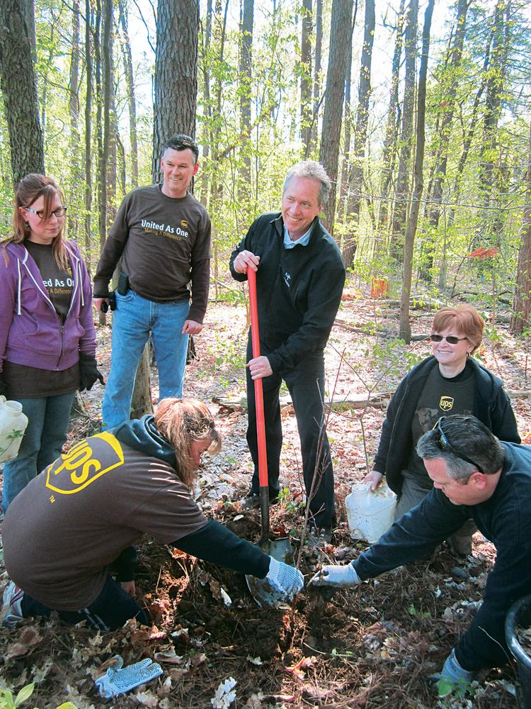 Louisville Mayor Greg Fischer, with shovel, worked with UPS employees as they planted trees in Jefferson Memorial Forest. The UPS employees are, from left: Leslie Herbert, Christina Weikel, Dan Thomas, Pam Davidson and Joe O'Bryan.