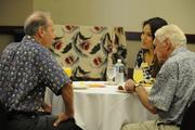 From left, Richard Schnitzler of Hamakua Macadamia Nut Co., Haidee Abe of First Hawaiian Bank and Edmund Olson of Hamakua Macadamia Nut Co. at the PBN's Hawaii's Fastest 50 reception prior to the event at the Hawaii Convention Center.