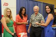 The ADP team, from left, Stephanie Stockin, Sandy Sanchez and Robyn Wolfe talk with Len Delekta, president of Image Apparel Hawaii, at the Pacific Business News Small Business Growth Expo.