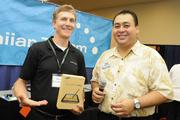 From left, Spero Constantine of Hawaiian Telcom and John Strandberg of Pacific Business News prepare to do a drawing for a Samsung Galaxy Note at the Pacific Business News Small Business Growth Expo.