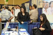 From left, Stephanie Maddox and Aja Burghardt of Express Employment Professionals at the Pacific Business News Small Business Growth Expo at the Hawaii Convention Center.