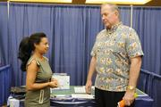 From left, Janayhe Self, president of the Hawaii Kai Chamber of Commerce, talks with Reg Baker of the Hawaii Medical Assurance Association at the Pacific Business News Small Business Growth Expo at the Hawaii Convention Center.