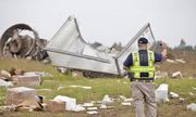NTSB crews investigate the crash site of UPS Airlines Flight 1354 on Friday in Birmingham, Ala.