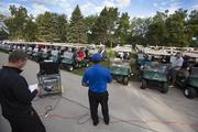 Golfers are given instructions before the event.
