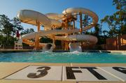 A photo of an existing VillaSport shows an outdoor waterslide on the property.