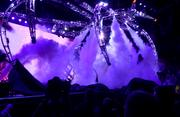 A giant metal spider-thing lowers from the rafters in a cloud of smoke. Either KISS is starting their set or something is very wrong.