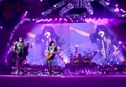 Gene Simmons, Tommy Thayer, Eric Singer on drums and Paul Stanley on the super big projection screen.