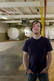 Wonderland Executive Director Adam Brouillette in the former Wonder Bread bakery building on North Fourth Street. The arts collective is looking at a different spot, in Franklinton, after plans fell through for it in Italian Village.