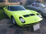 Yeahhh, baby! What a difference two years make. This 1969 Miura S eeks another 20 MPH out of the same 350 HP as the '67 400GT. But say hello to color. Key lime green, low slung and sexy, owner Mark Jansen has one of 338 built.