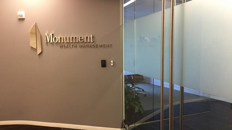 The entrance to the Monument Wealth Management suite on the fourth floor at 1701 Duke St. in Alexandria.