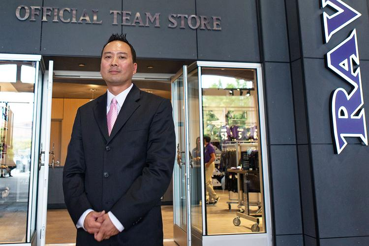 Chris Inouye, director of retail for the Baltimore Ravens, in front of a newly designed team store at M&T Bank Stadium. The stores will sell more  merchandise for female fans this season.