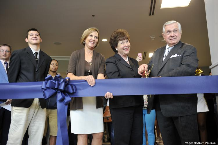 Queens University of Charlotte held a ribbon-cutting for its new, $30 million Levine Center for Wellness and Recreation. The three-story, 145,000-square-foot facility replaced the Ovens Athletic Center, which was built in the 1950s. From left are student Griffin Shaw, Queens President Pamela Davies, and Sandra and Leon Levine.