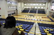 Students view the school's new gymnasium.