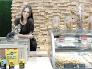 Jamee Yocum, owner of Bark Boutique, with her teacup Yorkie and handmade pet treats.
