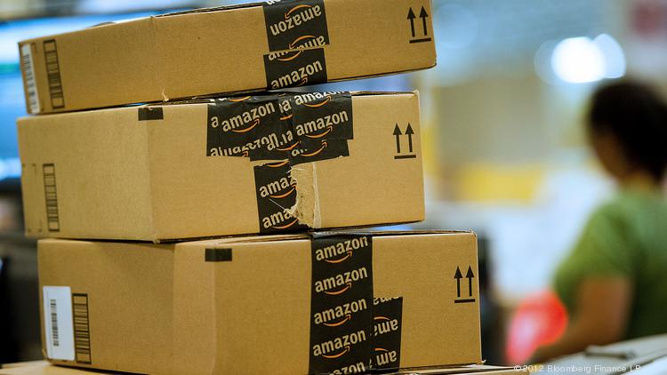 A new study shows online purchases decrease after Amazon begins collecting sales taxes on purchases. Photographer: David Paul Morris/Bloomberg