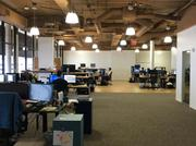 "PowerDMS Inc.'s open workspace, where ""the executive team sits in the open with everyone else."""