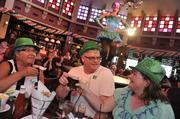 """The """"Mighty Festival,"""" continuing through March 17, features Irish bands and pro dancers, beers on tap, specially crafted food, face painting, stilt walkers and plenty of St. Patrick's Day memorabilia throughout Downtown Disney Pleasure Island."""