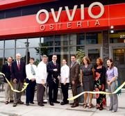 Ovvio Osteria celebrated the grand opening of its Merrifield location on Aug. 6. Joining in the festivities were, from left, Mike Collins, Rep. Gerry Connolly's outreach director; Del. Jim Scott; Supervisor Linda Smyth; Ovvio chef/partner Chris Watson; Ovvio General Manager Curtis Allred; Ovvio pastry chef Jennifer Short; Ovvio bar manager and sommelier Timothy Clune; Vist Fairfax's Sue Porter; Ovvio's Kim Anderson; Visit Fairfax's Alison Morris.
