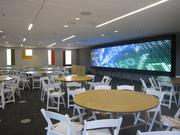 """The Avnet Information Space is the """"living room of McCord Hall"""" says Hillman. It will host orientations, recruiting sessions, and many other events. The room features a 21-screen display (seen here) as well as three other monitors in the back of the room."""
