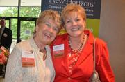 A couple of past Women in Business winners smile for the camera: Sheila Ogle with The Matthews House, and Sheila Ahler with Cherry Bekaert & Holland.