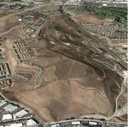 This great photo of the hill (that I found on the city of San Jose website) shows the topography of what developers are working with. The site requires (and has already commanded) a huge capital investment in infrastructure. The rising home market is what's driving the latest phase of the project to move forward.