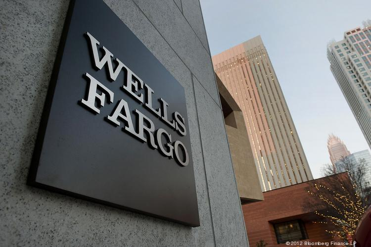 Wells Fargo is laying off 53 workers in Portland to reflect a slowdown in refinancings.