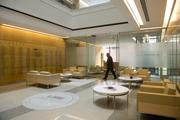 The design incorporates natural light, lots of glass and common areas to encourage collaboration.