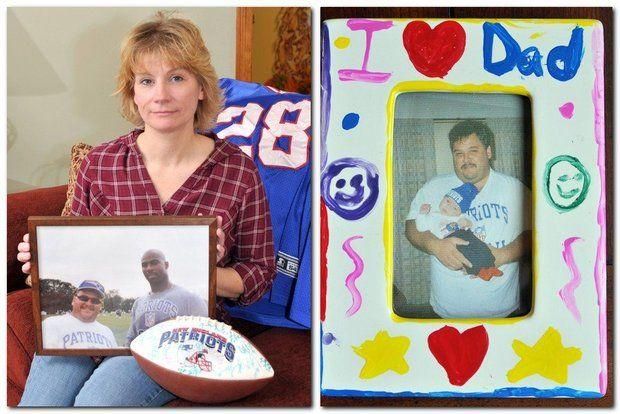 Kim Chartier, in 2010, holds a framed photo of her late husband Jeff, at left standing with New England Patriots player Ben Coates, right, at a summer football camp at Bryant College.
