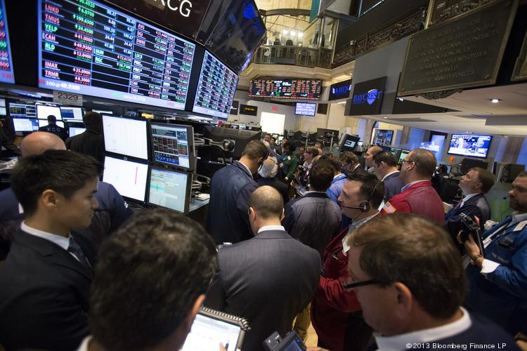 Traders work on the floor of the New York Stock Exchange (NYSE) in New York where many of the Triangle public companies have started trading.