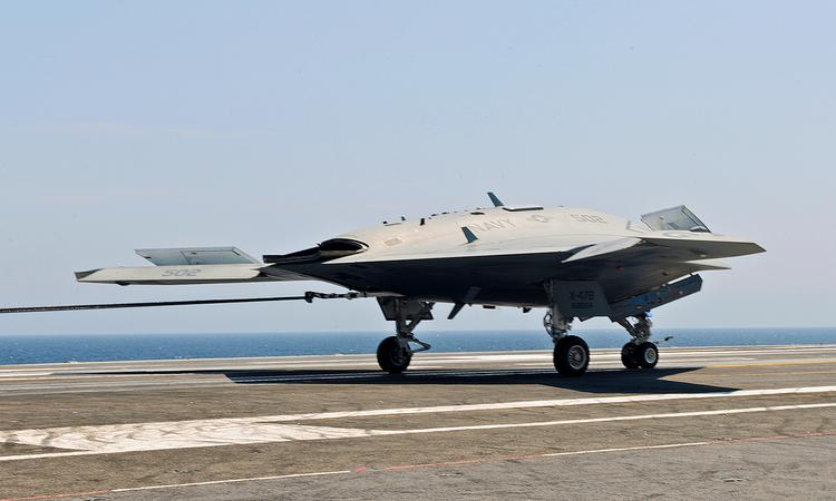 Northrop Grumman is among those to pitch designs for a carrier-based unmanned air system to the Navy, having already delivered X-47B aircraft, shown here, to test carrier-based launches by an autonomous, unmanned aircraft.