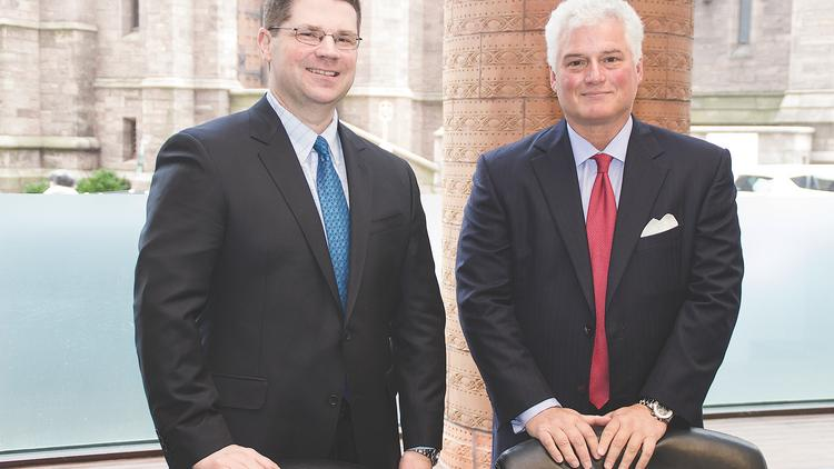 Attorneys Tim Hoover, left, and Daniel Oliverio of Hodgson Russ examined the impact of the U.S. Department of Justice's recent memorandum on efforts to pursue individuals as part of white-collar investigations.