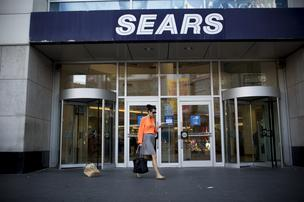 A shopper exits a Sears department store at the Toronto Eaton Centre in Toronto, Ontario, Canada.