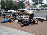 "Members of Charlotte Environmental Action staged a ""die-in"" protest Wednesday afternoon outside the Duke Energy Corp. headquarters to raise concern about drinking water pollution from coal ash contamination."