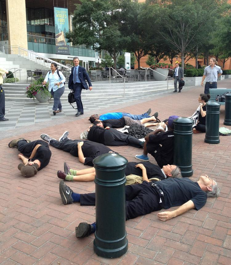 "Members of Charlotte Environmental Action staged a ""die-in"" protest Wednesday afternoon outside the Duke Energy Corp. headquarters to raise concern about drinking-water pollution from coal ash contamination."