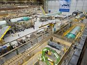 A fairly small crew assembles the 767, in a consolidated production line at the west end of the Everett factory, near the 747 line.