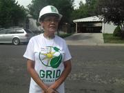 Roberta Lopez watches volunteers with Grid Alternatives install 2 kilowatt solar power system on her roof in Denver in August 2013.
