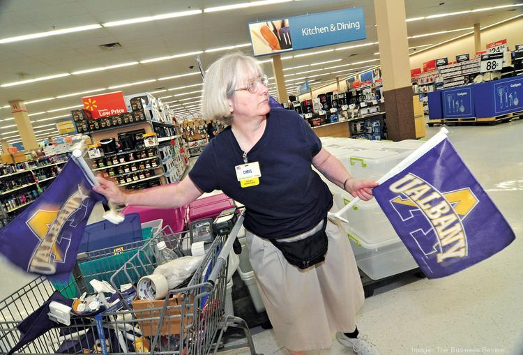 Walmart employee Chris Dushek is part of the team that gets the Albany store ready for the college crush.