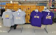 Storage crates and T-shirts sport familiar colors at the store