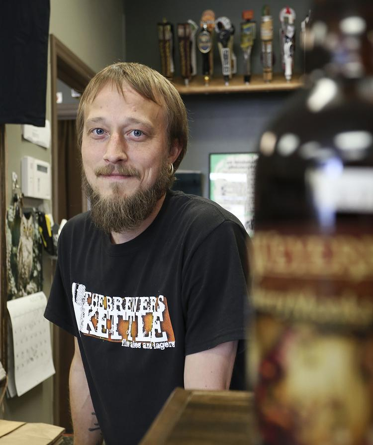 David Armstrong, owner of The Brewer's Kettle in High Point, is an example of young Triad professional who stayed in the region.