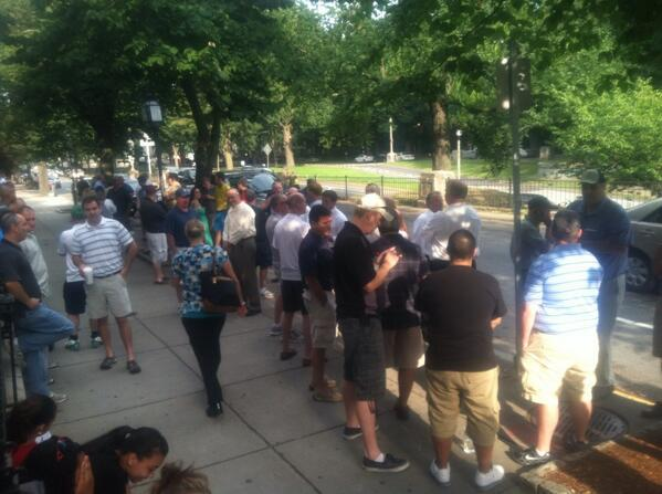Market Basket workers gathered outside the Harvard Club on Commonwealth Avenue in Boston's Back Bay for a Demoulas Super Markets board meeting that shifted locations at the last minute.