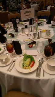 Lunch at OBJ's Business of Sports event included salad for starters and cheesecake for a sweet finale.