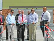 From left to right: Issa Ikhlayel, owner of the NuLu Edge Food Market, Louisville Mayor Greg Fischer, and Umang Patel, owner of the nearby Subway location, helped cut the ribbon.